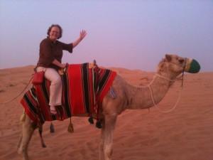 Penny on a camel in the Dubai Desert